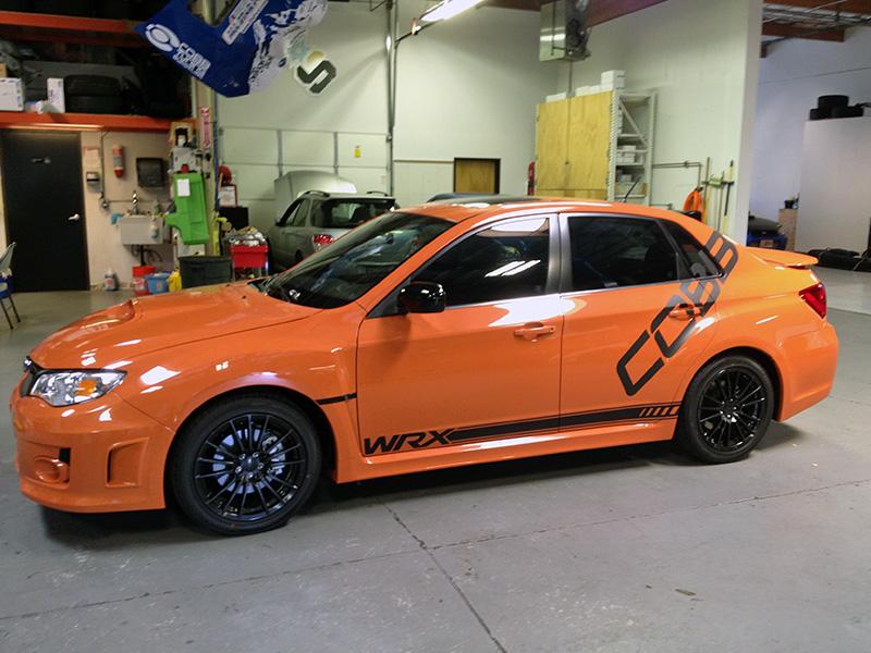 Orange Limited Subaru WRX STI Cobb Tuning Surgeline